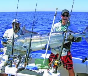 Shaun Manthey with a black marlin caught on Capricorn during March.