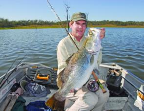 Wayne Kampe with a fat Monduran barra taken during his houseboat stay.