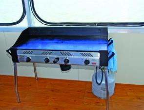 A four-burner BBQ is a handy kitchen accessory on the houseboat.