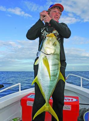The author's son Matthew Magner with a typical golden trevally trolled offshore from Bundaberg.