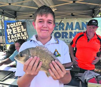 Casey Bates weighed in the first live fish for the competition on Friday – an awesome 542g bream.