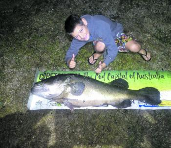 Billy with his 115cm that he caught on a surface paddler.