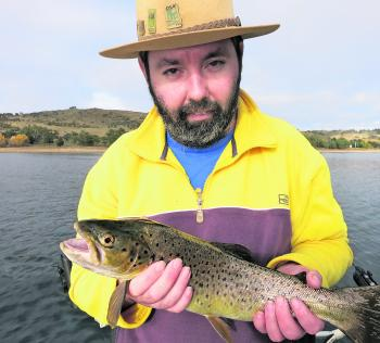 Luke Taylor holds up a beautifully colourful trout!