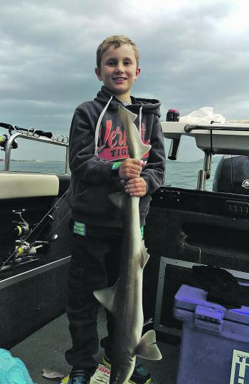 Ryder Thompson with a nice gummy caught during the run out tide on salmon fillet.