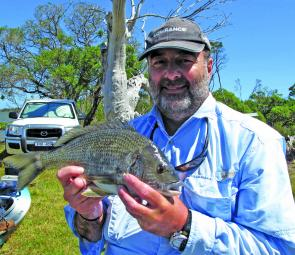 Chris Burbidge with a bream out of the live well ready for release.