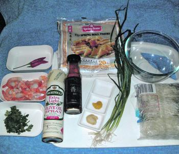 The ingredients. Handy hint: you can substitute very finely shredded and blanched cabbage for the vermicelli noodles.