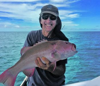 Quality coral trout, like this one caught by Ian Clarke, from Malanda, have been coming aboard off Cairns recently.