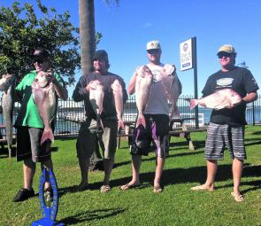 The boys with the spoils of a night's fishing – a good catch of snapper and a mulloway to boot.