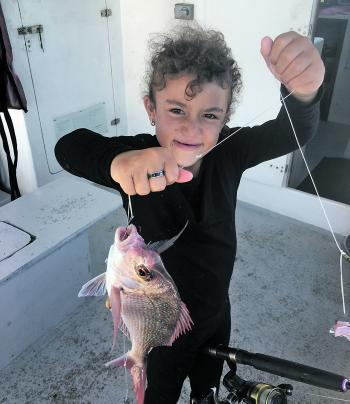 Lafita, six years old, with a nice snapper catch.