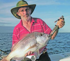 Trevor Toms with a soft plastic snapper caught with South Queensland Charter Services.