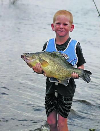 Jack Farrawell, age eight with a 50cm+ yella.