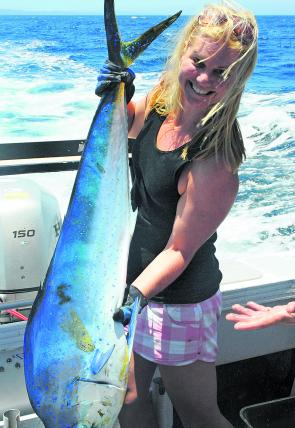 Julia Crilly holds up one of the beautifully marked mahi mahi that invade our offshore grounds at this time of year.