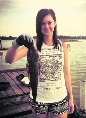 Chloe Jones with a flathead caught at the Lake Tyers boat ramp.