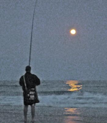 Fishing with the moon rising over the water is a special moment.