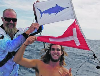 Paul Brodrick and Sam French celebrate Sam's first marlin tag and release, on Christmas Eve no less!