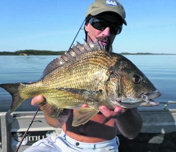 Gerard with a typical bream caught sight casting the flats.