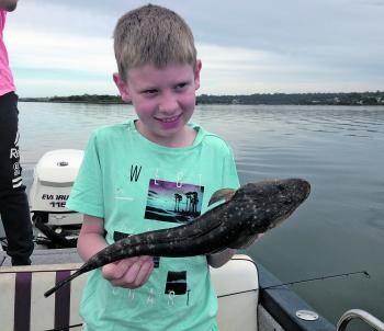 This angler is pleased with his first fish caught on a lure. Who wouldn't be?