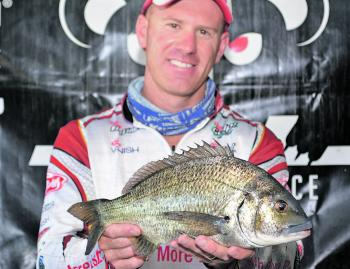 Brad Hodges from Team Berkley with the 1.13kg bream that handed his team the JML Anglers Alliance Big Bream.