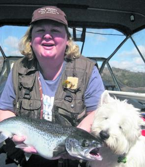 Amanda Walshaw and Finn the dog with an 5lb Atlantic salmon caught trolling a Willy's Special Tasmanian Devil lure.
