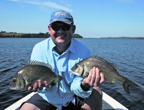 Peter Steward with a couple of solid black bream caught on plastics. In all, 21 bream were caught and released that morning.