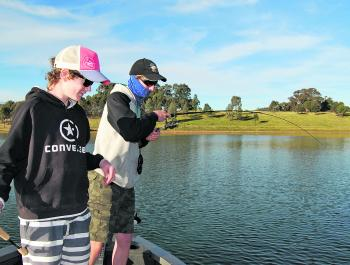 Blue skies, green grass, wispy white clouds, good mates and bent fishing rods. It's what Windamere Dam is all about in October.