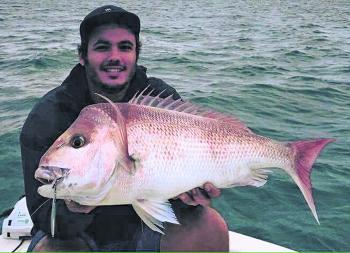 Aaron Winch with a great Moreton Bay snapper at 77cm. This fish was caught throwing a micro-jig lure at the Harry Atkinson artificial reef.
