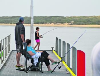 The jetty at the Marlo boat ramp is a popular place for families to relax and have a fish.