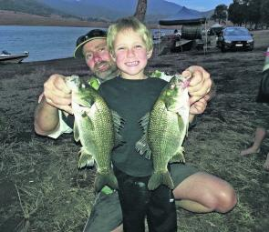 Greg Eslick and son Jasper at St Clair with a brace of bass.