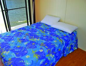 A pair of rooms set up with double beds are standard on the new houseboat.
