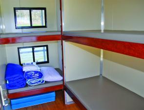 Four bunks are featured in this bedroom on the houseboat.
