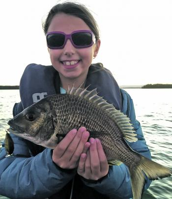 The author's daughter Bella with her PB bream, caught on a Damiki DTSCO hardbody. She was over the moon with this 38cm fish.