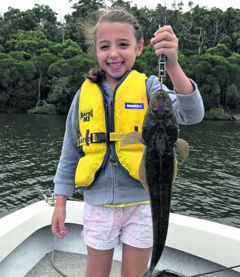 The author's daughter Bella with her first ever solo lure caught fish where she cast the lure and retrieved the fish unassisted. A very proud daddy indeed.