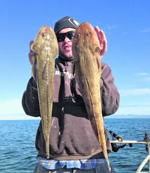 Danny shows off this pair of big flathead caught offshore near the islands. Winter is the time for big offshore flathead.