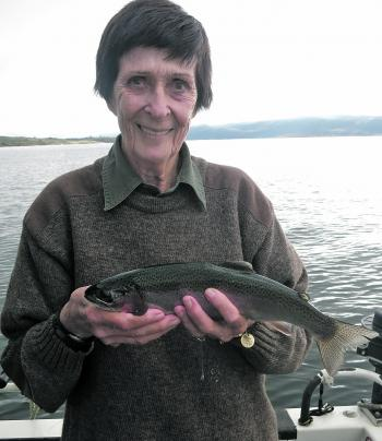 Nadine Lindsay with a rainbow trout caught trolling a holographic Tasmanian Devil. This is typical of the size of the rainbows currently being caught.