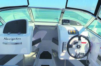 The passenger dash features a large glove box while the driver side has room to flush-mount a large fishfinder/GPS combo. There's a Mercury Vessel View at the top of the dash which gives all the necessary engine data.