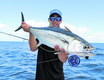 The author with a school size longtail tuna, which was fooled by a small baitfish imitation fly.