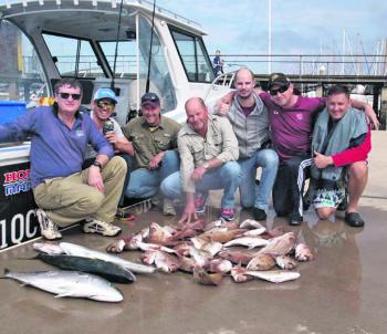 Happy anglers with their bag of squire and a couple of solid kingies