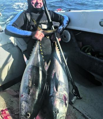 Mauro Molent with a heavy pair of tuna from Barwon Heads.