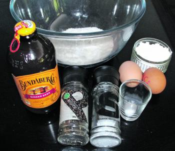 The ingredients for the batter – 1 cup self-raising flour, 1/2 cup cornflour, 2 eggs, 1/2 teaspoon bicarb soda, salt, pepper, 250ml ginger beer and potatoes (not pictured).