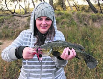 Hayley Macdonald sports a cold weather Murray cod taken slow rolling a spinnerbait early in the morning.