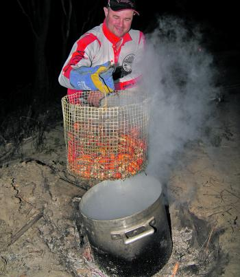 Gareth Lynch admires good haul of cooked yabbies from the Murray River.