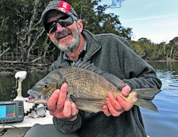 Bream fishing is so much easier when you have a 'lecky! That's iconic Aussie actor and comedian Garry McDonald (aka Norman Gunston) with a hefty bream he finessed from the shallows on a hardbodied minnow.