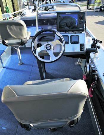The console and skippers seating configuration is spacious and functional.