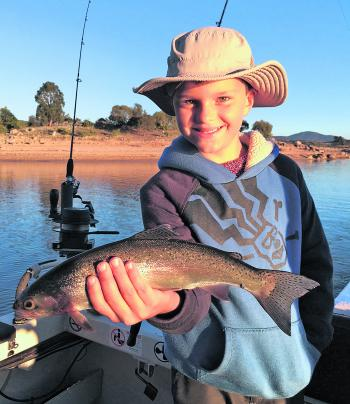 Young Edward Keys with his first ever trout – what an achievement!