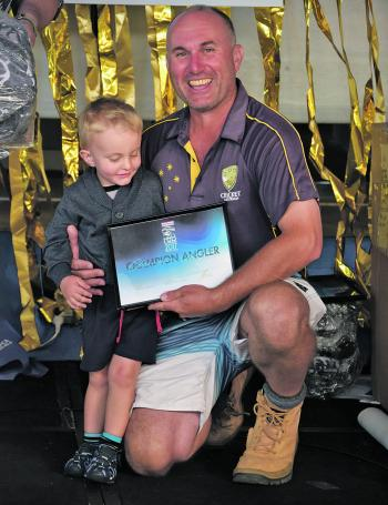 David Fraser took out first place and won a big smile from the little angler next to him.