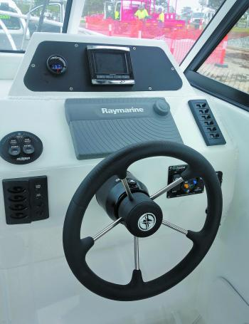 The helm is fitted with all the equipment needed for great fishing and safe boating.
