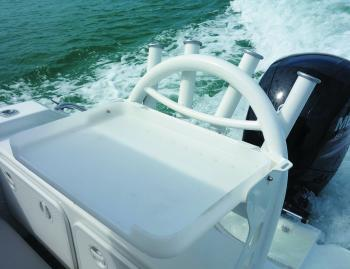 The bait board with rod holders is located over the hatches that are home to the batteries and deck wash.
