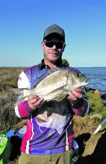 Matt White with a stonker black bream. He is one of a few anglers that can tweak lures and catch a heap of bream while others doing the exact same thing go fishless.