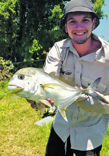 Sam Redman with a solid trevally taken from the upper tidal limit.