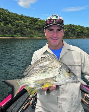 Local angling identity Glenn Helmers with a Lake Macquarie bream caught by working a surface lure along a rocky point. This fish was hooked mid-morning, but it generally pays to be on the water nice and early.